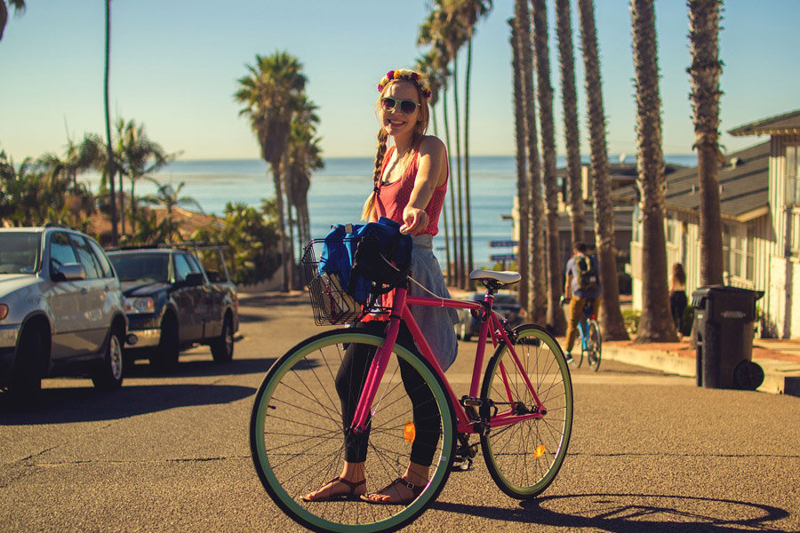 gorgeous woman holding her pink bike