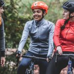 three women on bikes discussing common cycling mistakes
